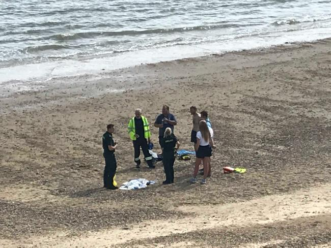 Emergency services on the beach where the tragedy unfolded
