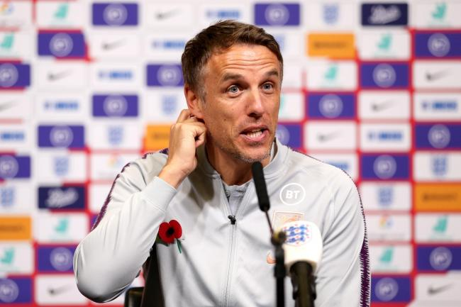 Phil Neville will lead his England side out in front of a record crowd at Wembley