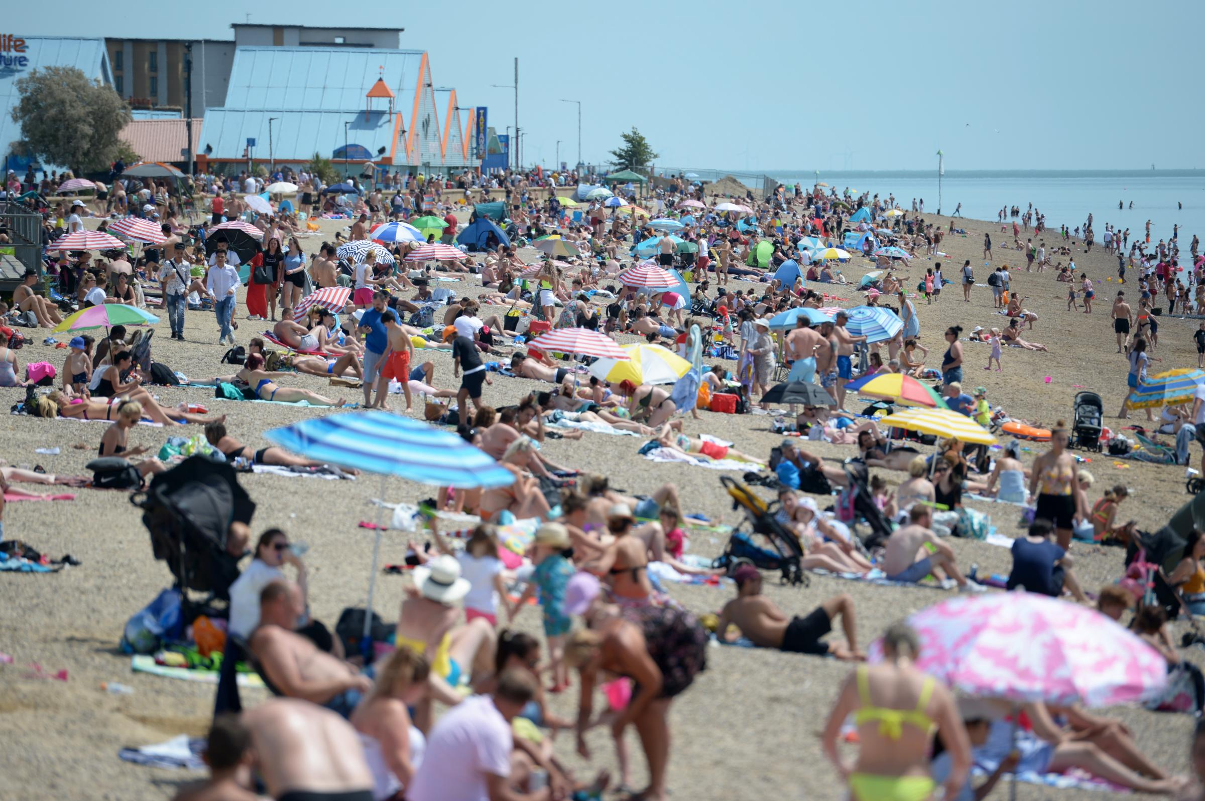 People enjoying the good weather on the beach at Southend