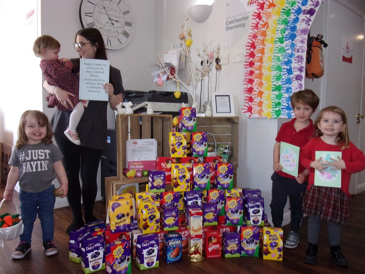 Reality choc - youngsters take stock of the delicious chocolate donated by parents. Marcie-Mae Etheridge is being held by Ashley Marsh, along with (from left) Meaghan Price, Leo Boot and Sophie Kelly