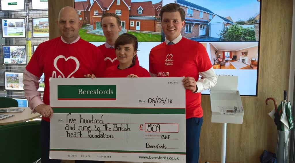 Beresford's team celebrates raising £509 for charity