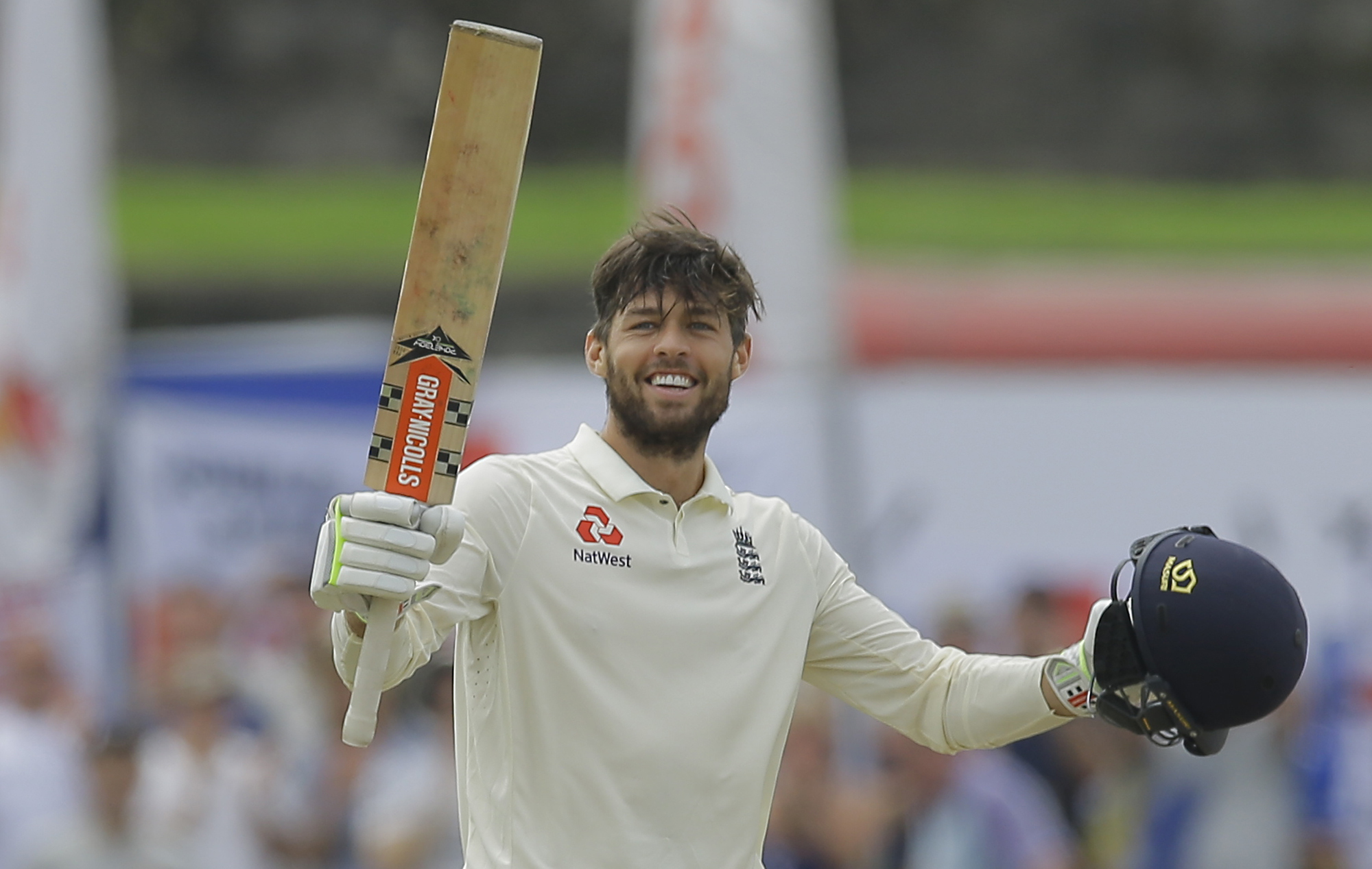 England's Ben Foakes celebrates scoring a century during the second day of the first test cricket match between Sri Lanka and England in Galle, Sri Lanka, Wednesday, Nov. 7, 2018. (AP Photo/Eranga Jayawardena).