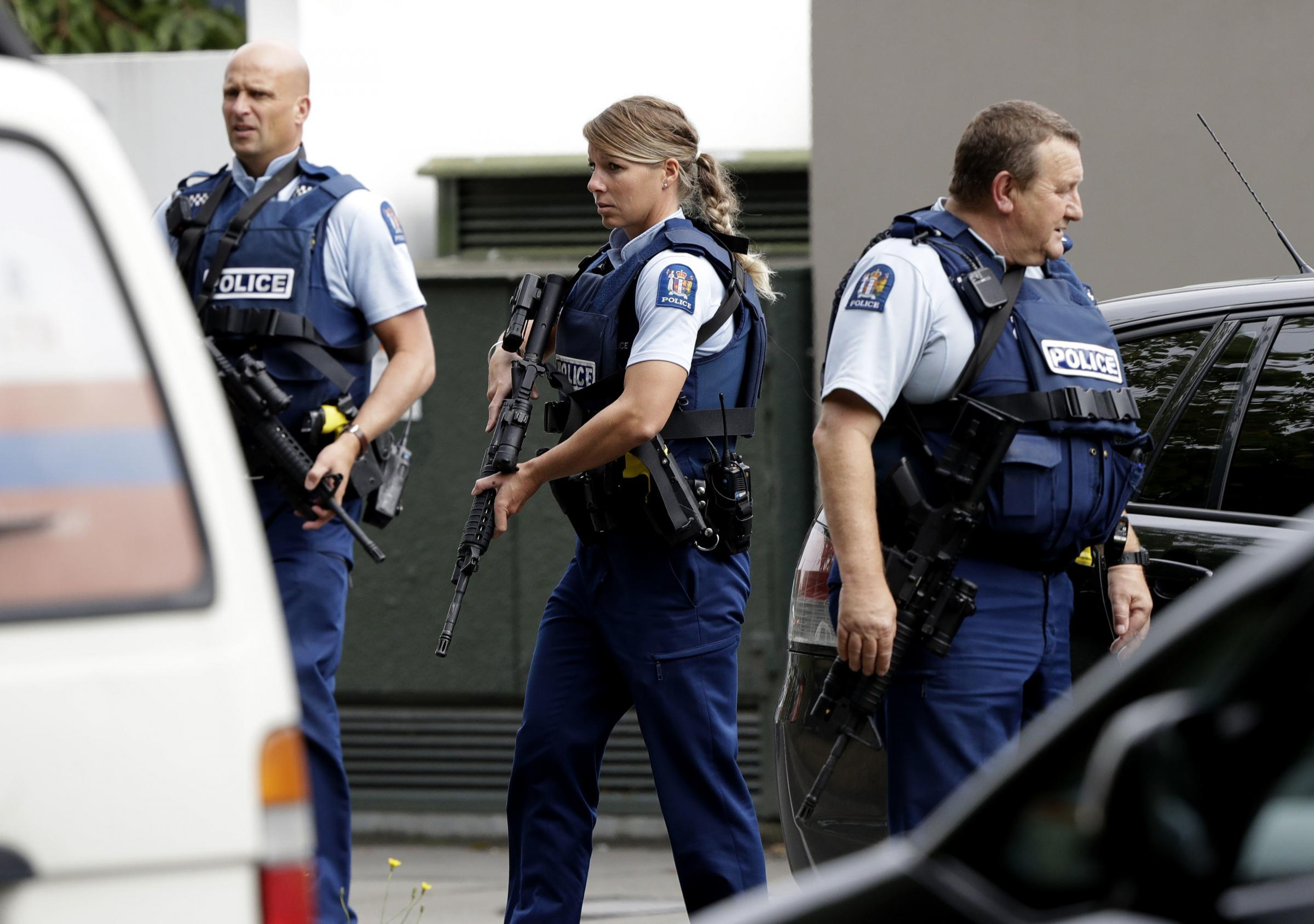 Armed police patrol outside a mosque in central Christchurch, New Zealand, Friday, March 15, 2019. A witness says many people have been killed in a mass shooting at a mosque in the New Zealand city of Christchurch. (AP Photo/Mark Baker)