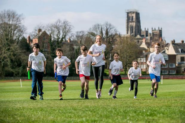 Brentwood Live: ON TRACK: Youngsters help Paula Radliffe launch Families on Track (from left) Frazer Ranns, 11, Harry Mason, 9, Sebastian Ranns, 10, Verity Ranns, 9, Emily Smith, 6, and Sam Mason, 12. Picture: SARAH CALDECOTT