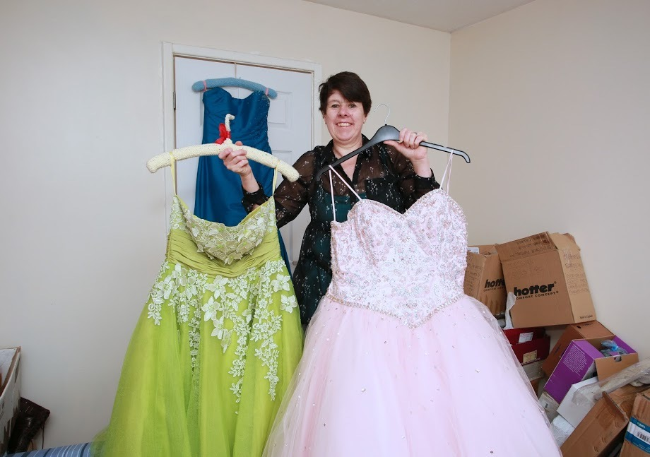 COMMUNITY DONATIONS: Charity Junction 7 are offering free prom dresses to those who are struggling financially, pictured of secretary Jane Johnson Picture: SARAH CALDECOTT